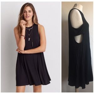 Little black swing dress with side cutouts
